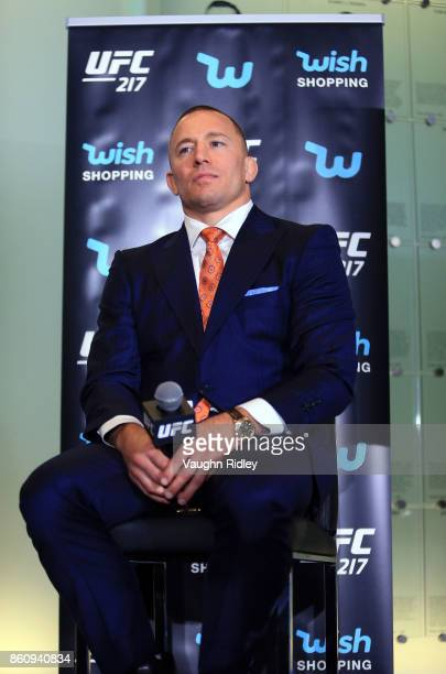 Georges StPierre looks on during the UFC 217 press conference with Michael Bisping and Dana White at the Hockey Hall of Fame on October 13 2017 in...