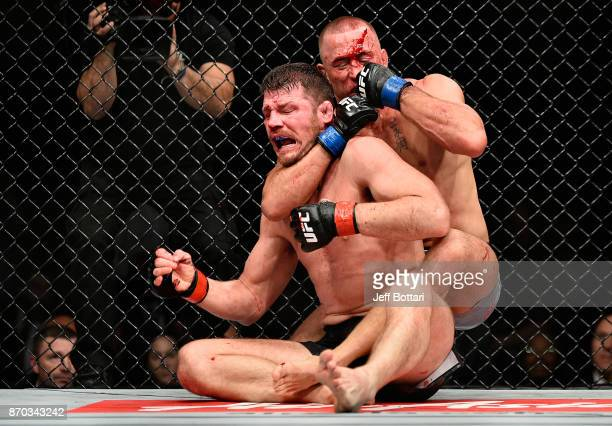 Georges StPierre of Canada brings down Michael Bisping of England in their UFC middleweight championship bout during the UFC 217 event at Madison...