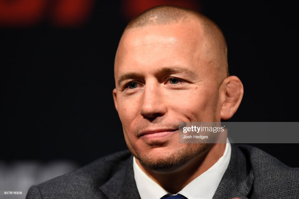 Georges St-Pierre of Canada interacts with UFC middleweight champion Michael Bisping of England during the UFC press conference at T-Mobile arena on March 3, 2017 in Las Vegas, Nevada.
