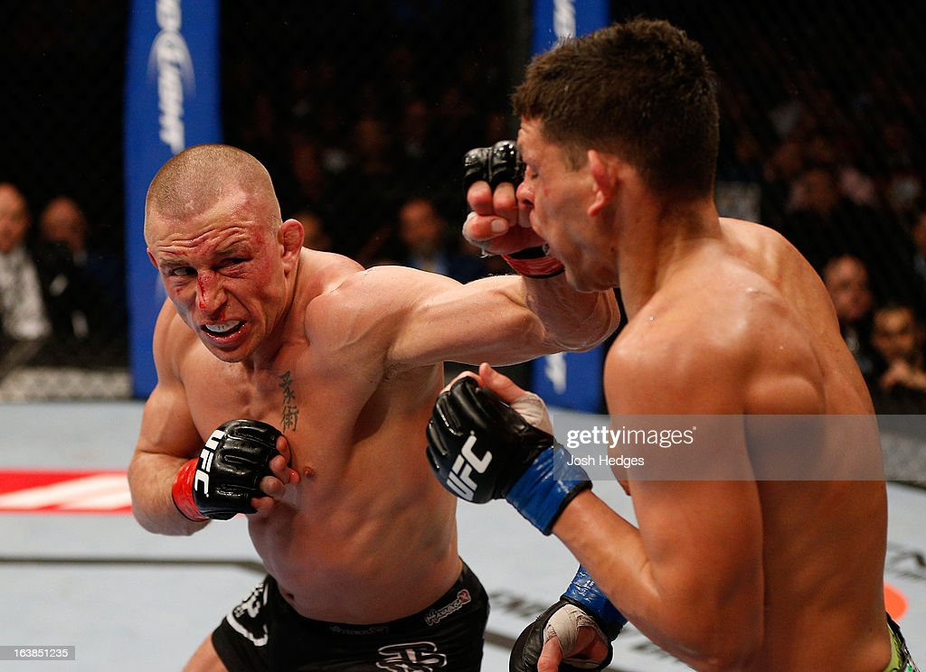 <a gi-track='captionPersonalityLinkClicked' href=/galleries/search?phrase=Georges+St-Pierre&family=editorial&specificpeople=4864241 ng-click='$event.stopPropagation()'>Georges St-Pierre</a> punches <a gi-track='captionPersonalityLinkClicked' href=/galleries/search?phrase=Nick+Diaz&family=editorial&specificpeople=5350175 ng-click='$event.stopPropagation()'>Nick Diaz</a> in their welterweight championship bout during the UFC 158 event at Bell Centre on March 16, 2013 in Montreal, Quebec, Canada.