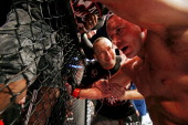 Georges StPierre reacts after fighting against Carlos Condit in the welterweight title bout during UFC 154 on November 17 2012 at the Bell Centre in...