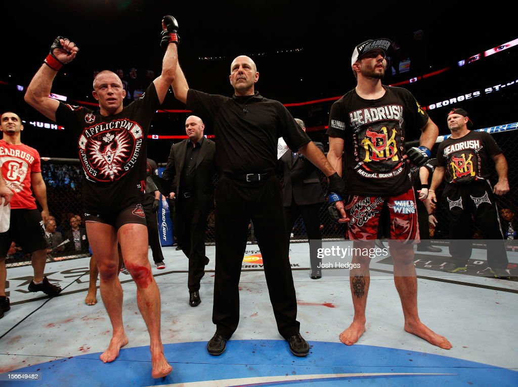Georges St-Pierre (L) reacts after winning his fight against Carlos Condit by a unanimous decision to retain his welterweight title during UFC 154 on November 17, 2012 at the Bell Centre in Montreal, Canada.