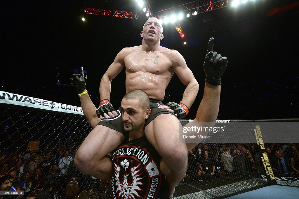 <a gi-track='captionPersonalityLinkClicked' href=/galleries/search?phrase=Georges+St-Pierre&family=editorial&specificpeople=4864241 ng-click='$event.stopPropagation()'>Georges St-Pierre</a> (top) reacts to his victory over Johny Hendricks in their UFC welterweight championship bout during the UFC 167 event inside the MGM Grand Garden Arena on November 16, 2013 in Las Vegas, Nevada.