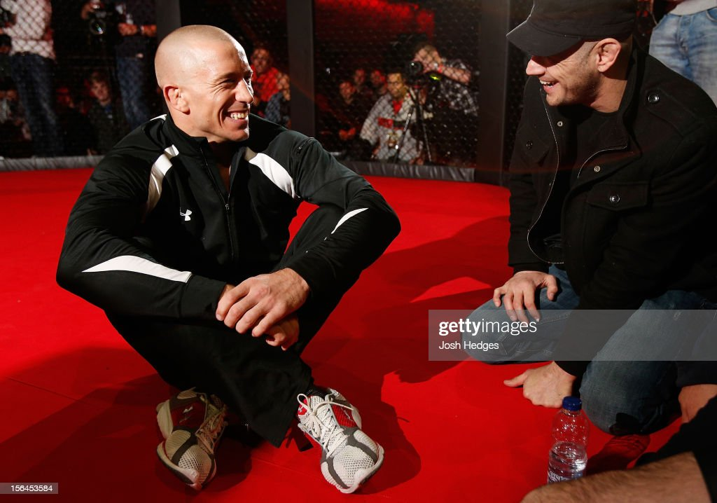 Georges St-Pierre sits in the Octagon during an open training session ahead of UFC 154 at New City Gas on November 15, 2012 in Montreal, Quebec, Canada.