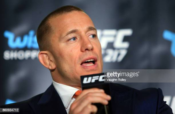Georges StPierre speaks to the media during the UFC 217 press conference with Dana White and Michael Bisping at the Hockey Hall of Fame on October 13...