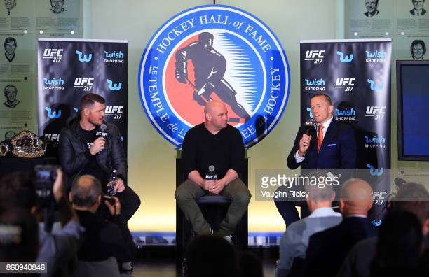 Georges StPierre speaks to the media during the UFC 217 press conference with Michael Bisping and Dana White at the Hockey Hall of Fame on October 13...