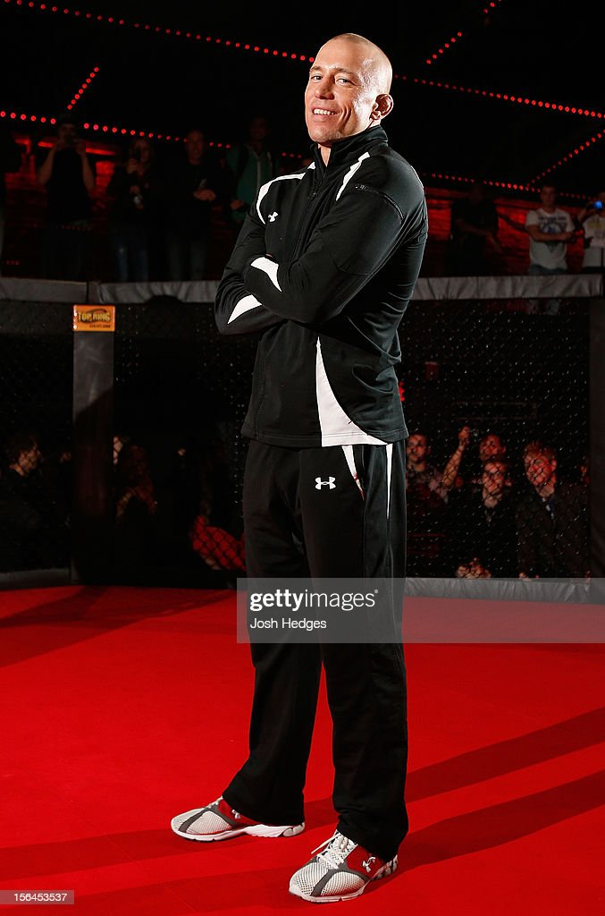 <a gi-track='captionPersonalityLinkClicked' href=/galleries/search?phrase=Georges+St-Pierre&family=editorial&specificpeople=4864241 ng-click='$event.stopPropagation()'>Georges St-Pierre</a> stands in the Octagon during an open training session ahead of UFC 154 at New City Gas on November 15, 2012 in Montreal, Quebec, Canada.