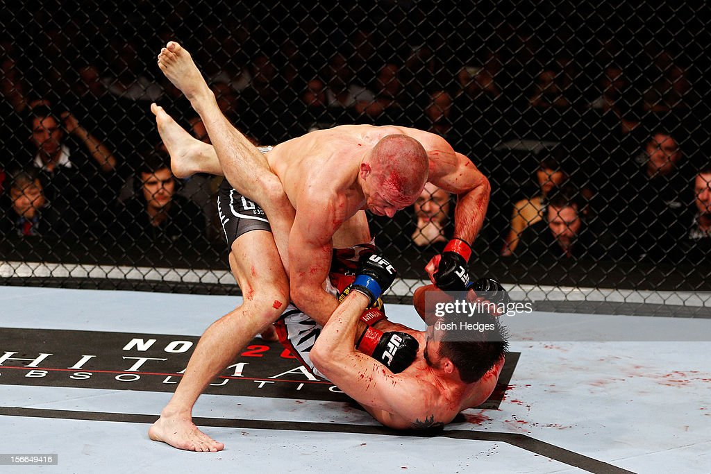 Georges St-Pierre throws a punch to the face of Carlos Condit in their welterweight title bout during UFC 154 on November 17, 2012 at the Bell Centre in Montreal, Canada.
