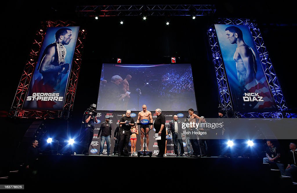 <a gi-track='captionPersonalityLinkClicked' href=/galleries/search?phrase=Georges+St-Pierre&family=editorial&specificpeople=4864241 ng-click='$event.stopPropagation()'>Georges St-Pierre</a> weighs in during the UFC 158 weigh-in at Bell Centre on March 15, 2013 in Montreal, Quebec, Canada.