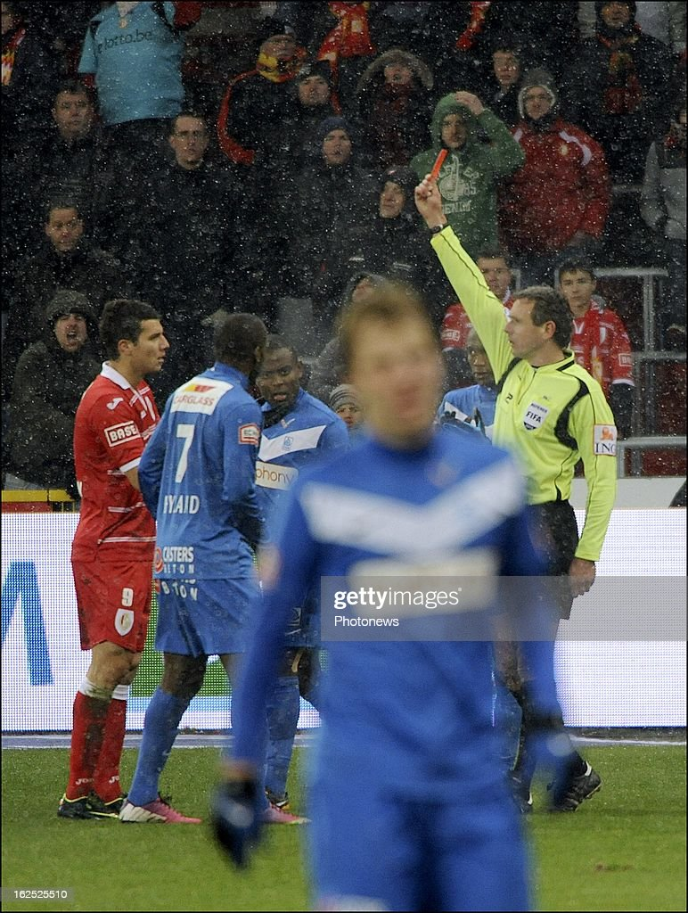 Georges Tucudean of Standard Liege received a red card from referee Luc Wouters in action during the Jupiler League match between Standard de Liege and KRC Genk on February 24, 2013 in Liege, Belgium.