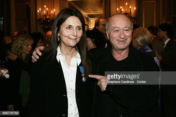 Georges Wolinski and Michele Reiser celebrate the presentation of the 'Chevalier de l'Ordre National du Merite' award to writer and director Michele...