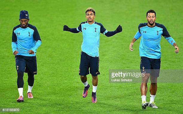 GeorgesKevin Nkoudou Marcus Edwards and Mousa Dembele of Tottenham Hotspur warm up during a Tottenham Hotspur training session and press conference...