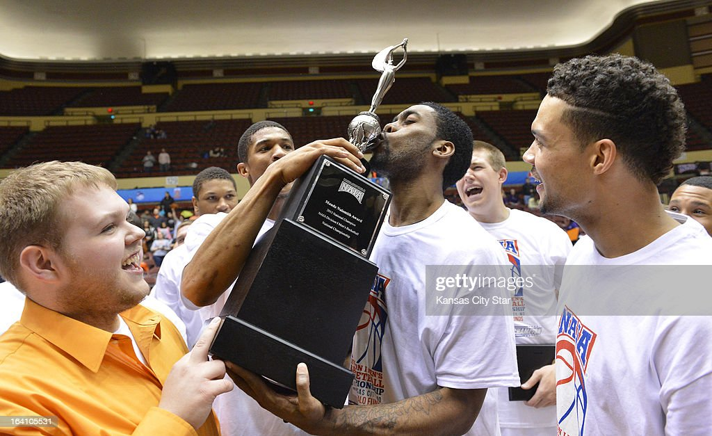 Georgetown (Ky.) College's Allan Thomas kisses the NAIA championship trophy. Georgetown beat Southwestern Assemblies of God University, 88-62, in the NAIA Division 1 men's national championship at Municipal Auditorium in Kansas City, Missouri, Tuesday, March 19, 2013.