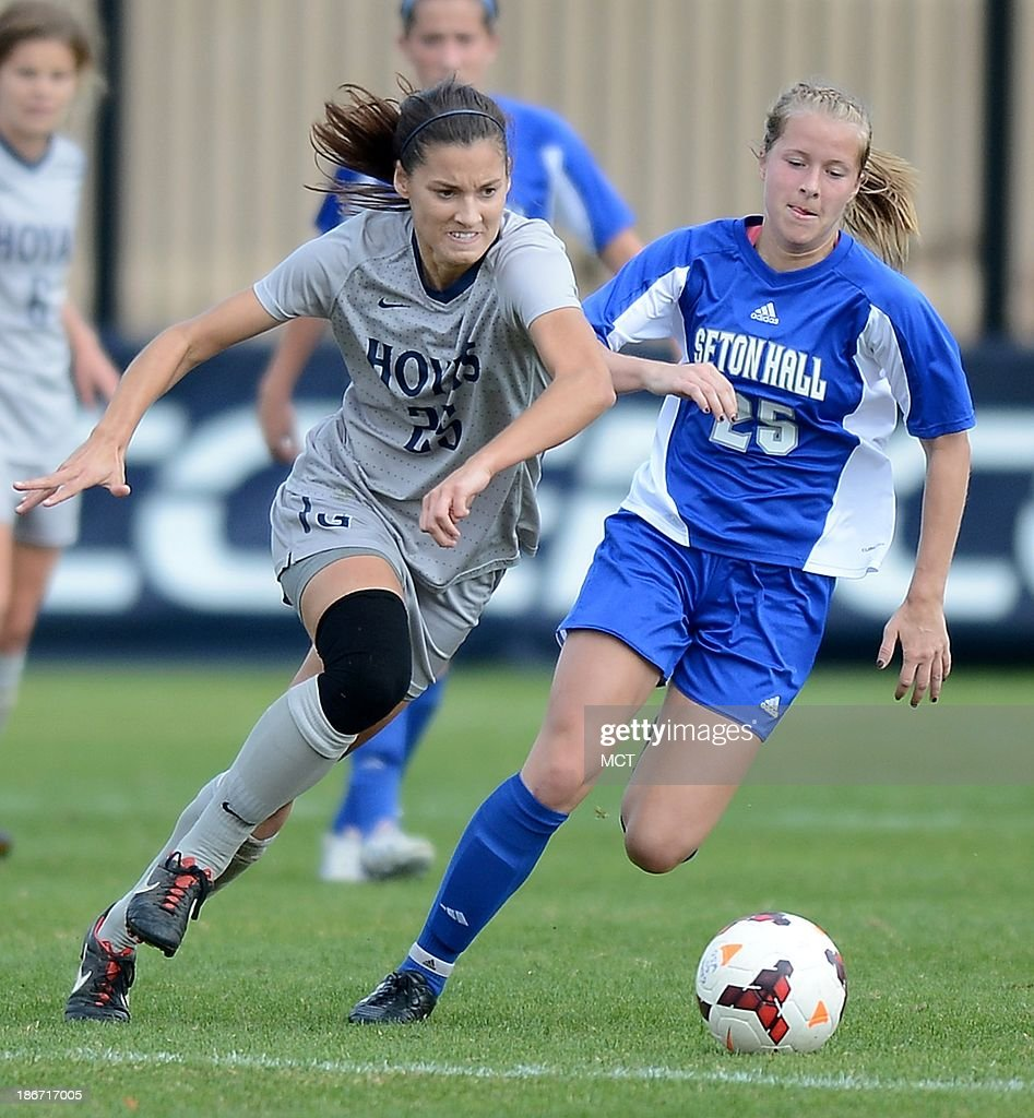 Georgetown defender Kailey Blain (25), left, breaks after the ball against Seton Hall midfielder Marie Klemme (25), right, during first-half action at Shaw Field on the Georgetown campus in Washington, D.C., Saturday, November 2, 2013. Georgetown defeated Seton Hall, 2-0.