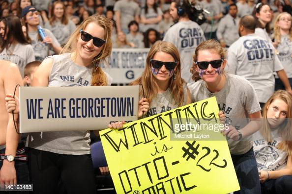 Georgetown fans cheer during a college basketball game against the Villanova Wildcats on February 25 2012 at the Verizon Center in Washington DC The...