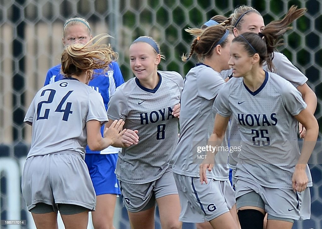 Georgetown forward Audra Ayotte (8) celebrates with teammates following her goal against Seton Hall in the first half at Shaw Field on the Georgetown campus in Washington, D.C., Saturday, November 2, 2013. Georgetown defeated Seton Hall, 2-0.