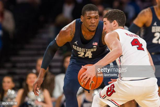 Georgetown Forward Marcus Derrickson guards against St John Guard Federico Mussini during the first round of the BigEast Conference men's basketball...