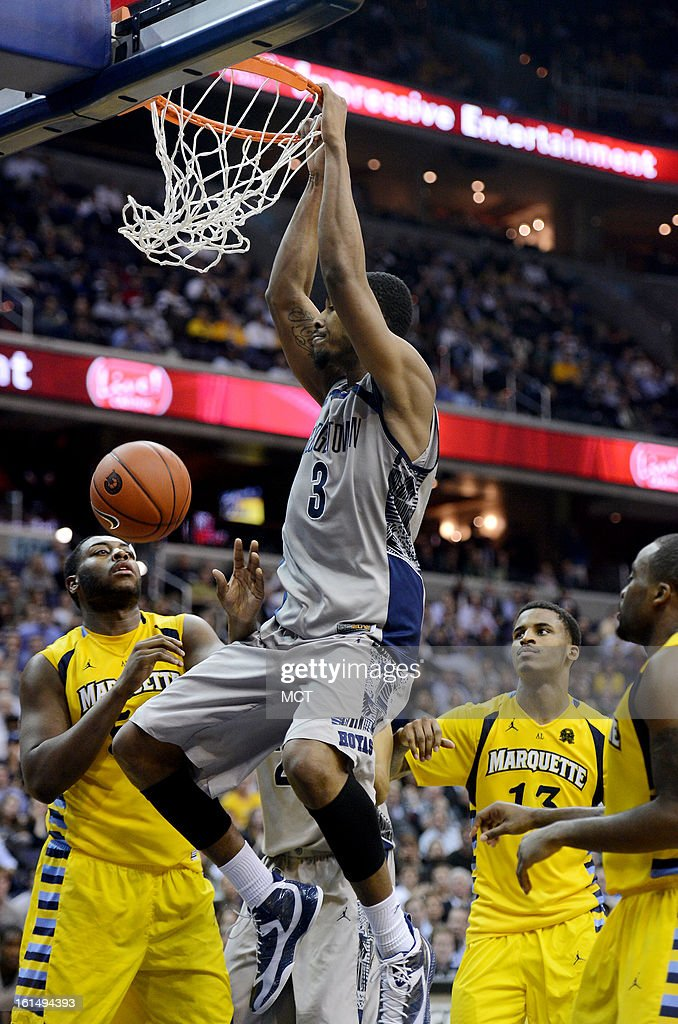 Georgetown forward Mikael Hopkins (3) dunks past three Marquette defenders in the second half at the Verizon Center in Washington, D.C., Monday, February 11, 2013. Georgetown defeated Marquette, 63-55.