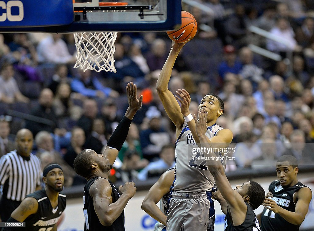 Georgetown forward Otto Porter Jr. (22), center, shoot in a crowd during the Georgetown Hoyas defeat of the Providence Friars 74 - 65 in mens NCAA basketball at the Verizon Center in Washington DC, January 16, 2012 .