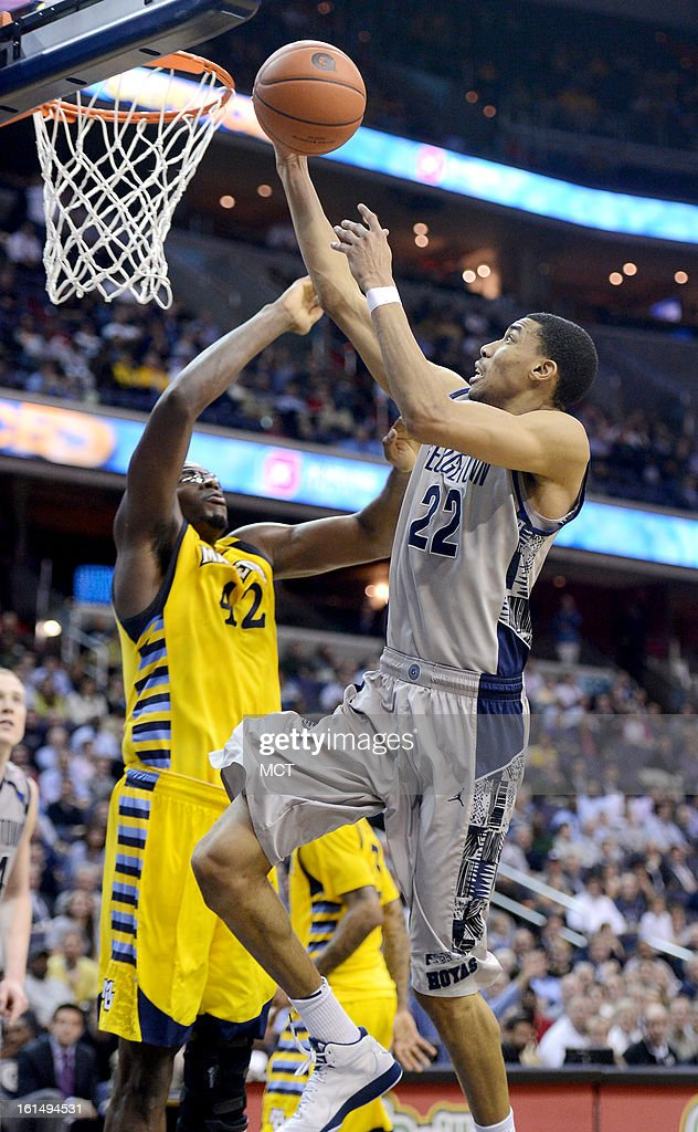 Georgetown forward Otto Porter Jr. (22) lays up a score against Marquette center Chris Otule (42) in the second half at the Verizon Center in Washington, D.C., Monday, February 11, 2013. Georgetown defeated Marquette, 63-55.