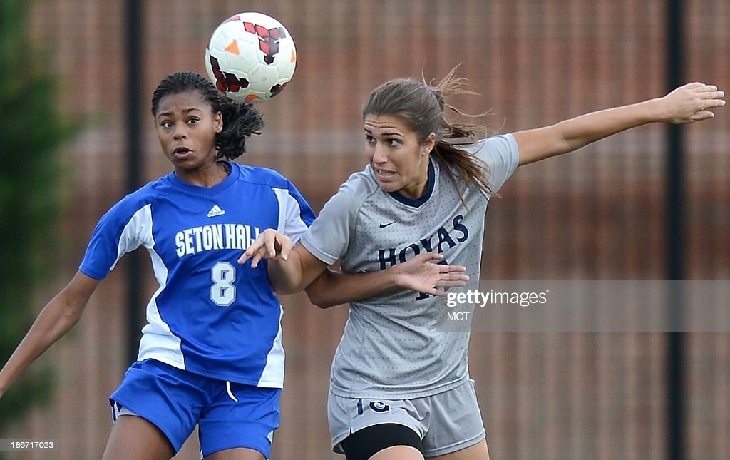 Georgetown forward Vanessa Skrumbis (13) and Seton Hall defender Melissa Blevins (8) make a play for the ball during first-half action at Shaw Field on the Georgetown campus in Washington, D.C., Saturday, November 2, 2013. Georgetown defeated Seton Hall, 2-0.