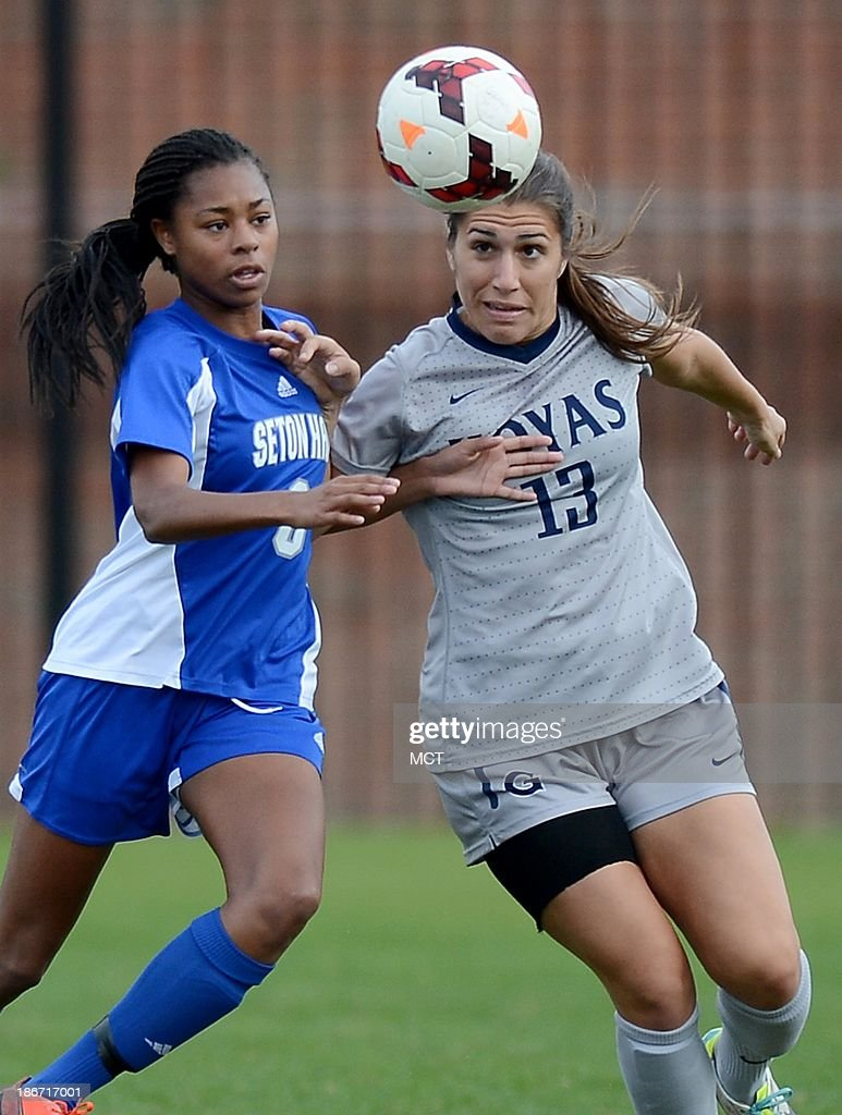 Georgetown forward Vanessa Skrumbis (13) tries to make a play on the ball against Seton Hall defender Melissa Blevins (8) during first-half action at Shaw Field on the Georgetown campus in Washington, D.C., Saturday, November 2, 2013. Georgetown defeated Seton Hall, 2-0.