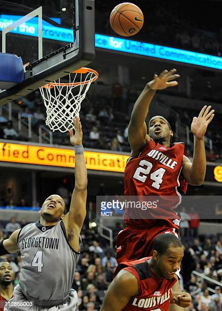 Georgetown guard Chris Wright attempts to score past Louisville forward Samardo Samuels during second half action at the Verizon Center in Washington...