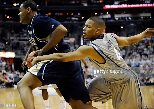 Georgetown guard Chris Wright attempts to steal the ball from Pittsburgh forward Tyrell Biggs left during first half action at the Verizon Center in...