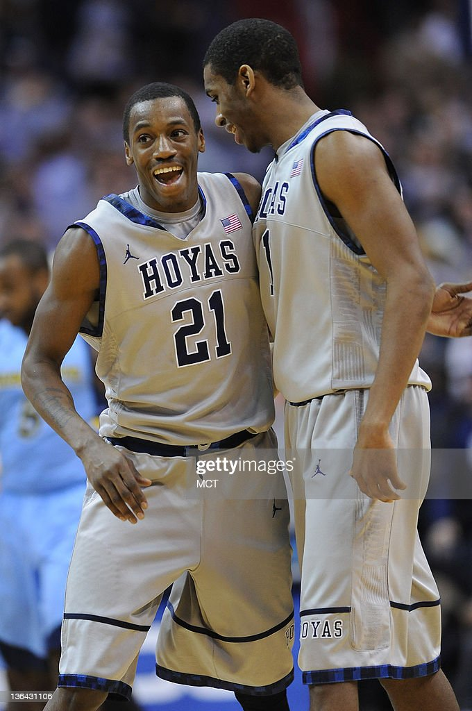 Georgetown guard Jason Clark (21) and forward Hollis Thompson (1) celebrate following a Georgetown defensive stop against Marquette late in the second half at the Verizon Center in Washington, D.C., Wednesday, January 4, 2012. Georgetown beat Marquette, 73-70.