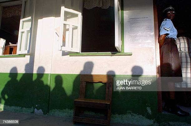In this 19 March 2001 file photo a Guyanese police officer stands in the door way of a polling station in Georgetown Guyana Four suspected Islamic...