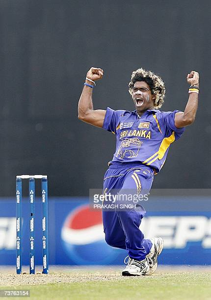 Sri Lanka's Lasith Malinga celebrates the wicket of West Indies Chris Gayle during the World Cup Super Eight match against the West Indies at Guyana...
