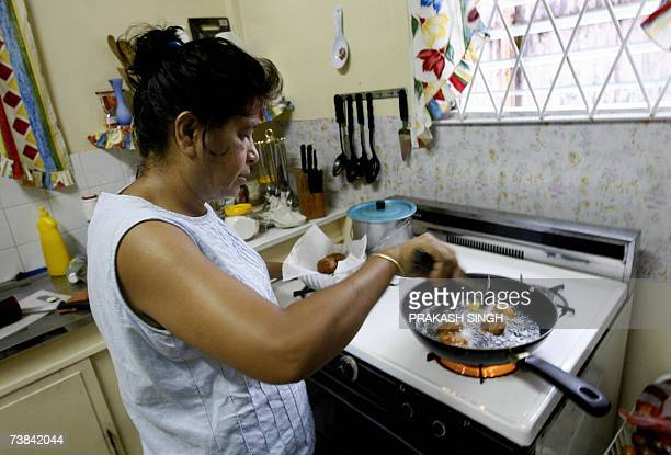 This picture taken on 06 April 2007 shows Guyanese Hindu Chandana Jagunandan cooks Indian snacks vegetable pakoras in her Queenstown home in Guyana...