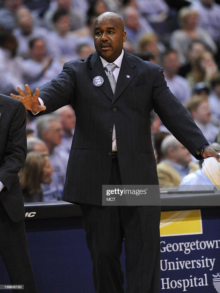 Georgetown head coach John Thompson III calms Georgetown guard Jason Clark not pictured after a disputed call during the first half against Villanova...