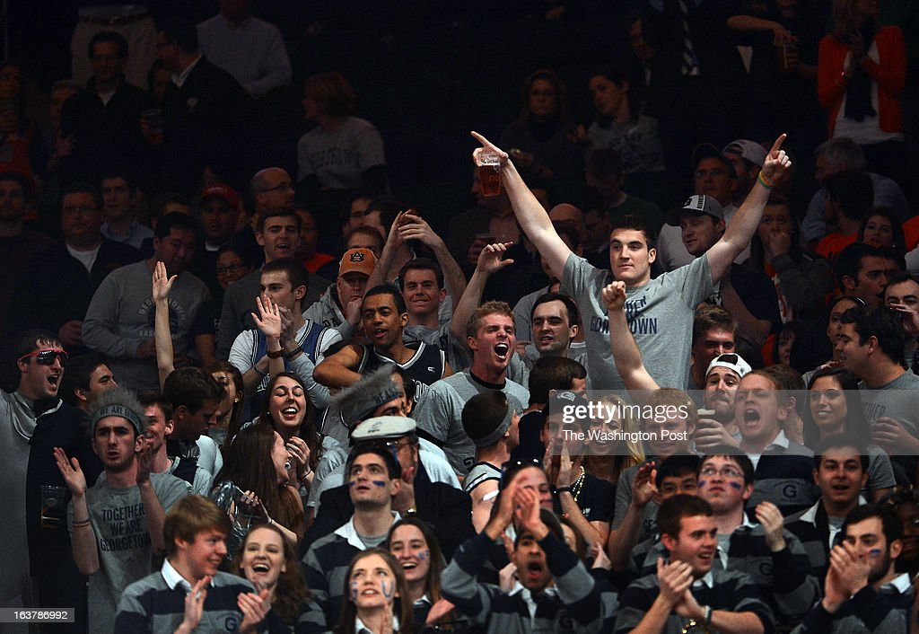 Georgetown Hoya fans celebrate a basket during the first half of their Semifinal Round game of the Big East Championship at Madison Square Garden on Friday, March 15, 2013.