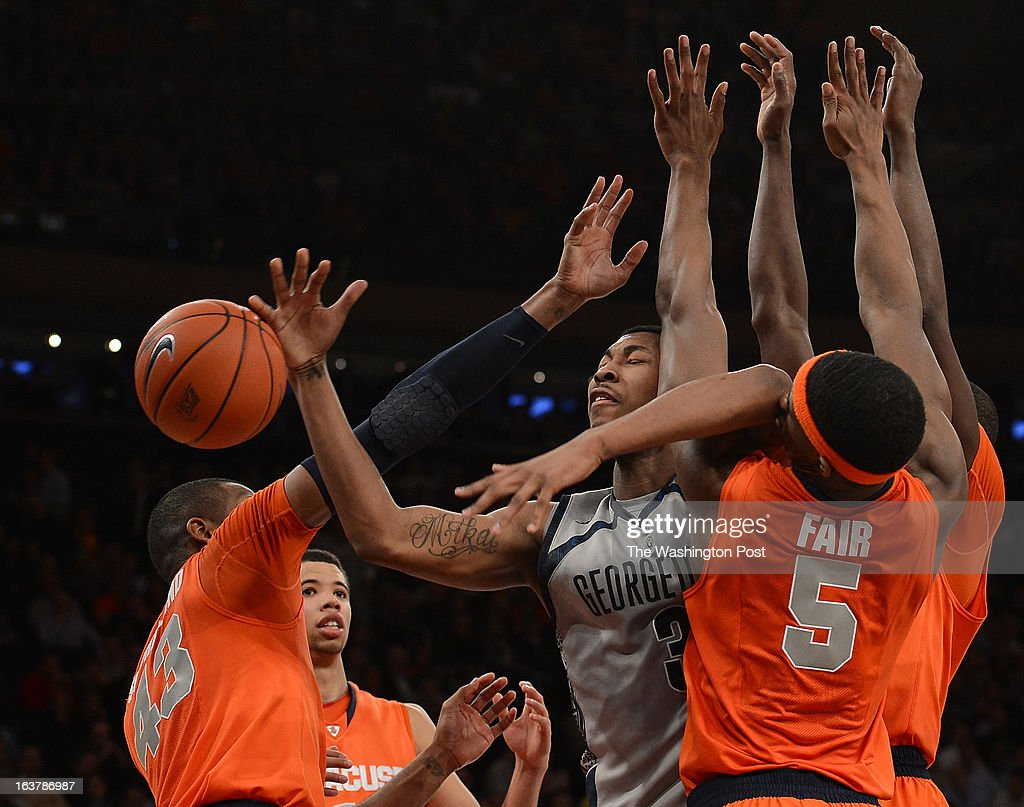 Georgetown Hoyas center Mikael Hopkins (3) can't grab the offensive rebound as he is surrounded by Syracuse Orange player during overtime of a Semifinal Round game of the Big East Championship at Madison Square Garden on Friday, March 15, 2013. The Georgetown Hoyas lost to the Syracuse Orange 58-55 in overtime.