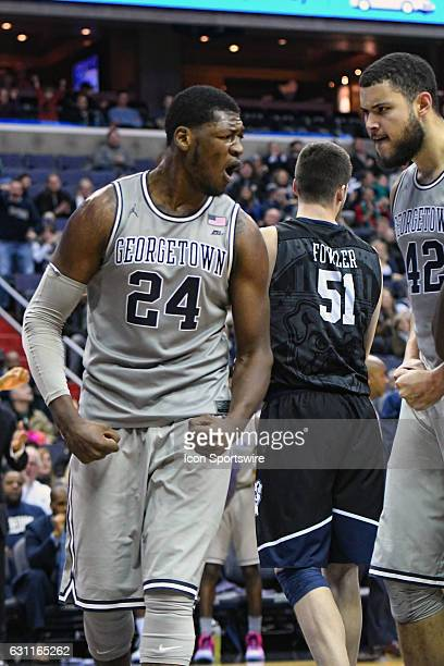 Georgetown Hoyas forward Marcus Derrickson celebrates with center Bradley Hayes after scoring and being fouled by Butler Bulldogs center Nate Fowler...