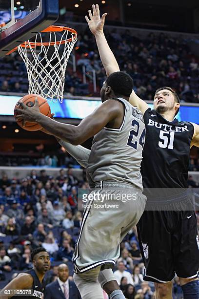 Georgetown Hoyas forward Marcus Derrickson fails to score in overtime against Butler Bulldogs center Nate Fowler on January 7 at the Verizon Center...