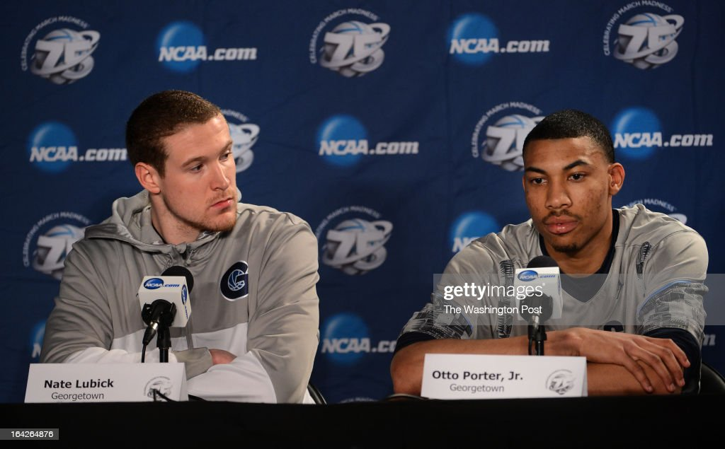 Georgetown Hoyas forward Nate Lubick (34, let, looks over as Georgetown Hoyas forward Otto Porter Jr. (22), right, answers a question from the media during a press conference before practicing at the Wells Fargo Center on Thursday, March 21, 2013.