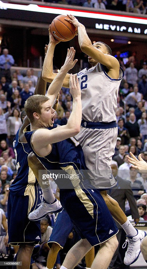 Georgetown Hoyas forward Otto Porter (22) crashes into Notre Dame Fighting Irish guard Scott Martin (14) during the second half of their game played at the Verizon Center in Washington, D.C., Monday, February 27, 2012. Georgetown defeated Notre Dame 59-41.