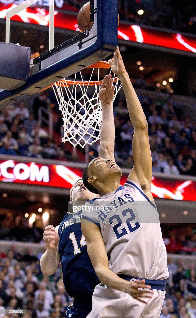 Georgetown Hoyas forward Otto Porter (22) does a reverse layup over Notre Dame Fighting Irish guard Scott Martin (14) during the second half of their game played at the Verizon Center in Washington, D.C., Monday, February 27, 2012. Georgetown defeated Notre Dame 59-41.