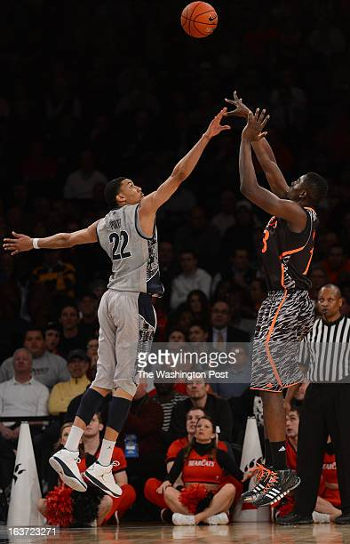 Georgetown Hoyas forward Otto Porter Jr disrupts the shot of Cincinnati Bearcats center Cheikh Mbodj during the Quarterfinal Round game of the Big...