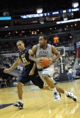 Georgetown Hoyas guard Austin Freeman drives past West Virginia Mountaineers guard Joe Mazzulla during the game at the Verizon Center on Saturday...