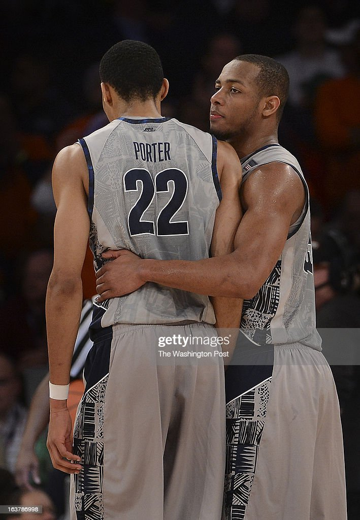 Georgetown Hoyas guard Jabril Trawick (55), right, and Georgetown Hoyas forward Otto Porter Jr. (22) after Porter gets called for a foul near the end of overtime during a Semifinal Round game of the Big East Championship at Madison Square Garden on Friday, March 15, 2013. The Georgetown Hoyas lost to the Syracuse Orange 58-55 in overtime.