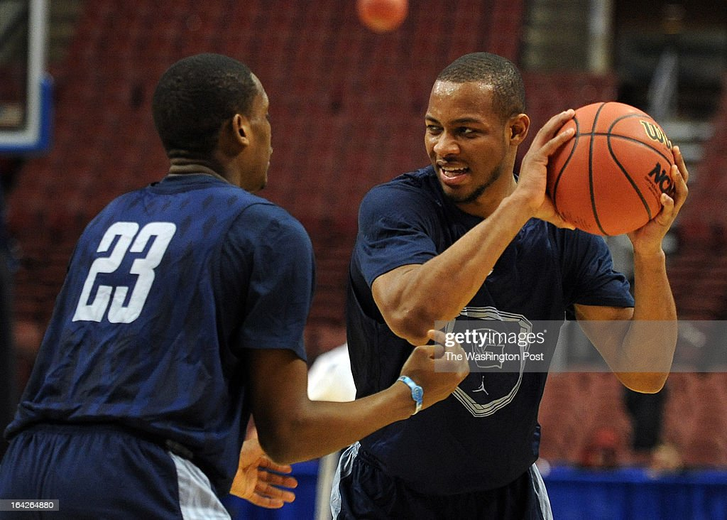 Georgetown Hoyas guard Jabril Trawick (55), right, looks to move the ball around Georgetown Hoyas forward Aaron Bowen (23) during practice before the first round of the NCAA Tournament at the Wells Fargo Center on Thursday, March 21, 2013.