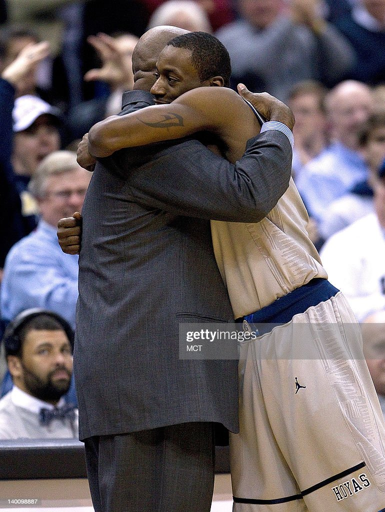 Georgetown Hoyas guard Jason Clark hugs Georgetown Hoyas Head Coach John Thompson III in the final seconds of their game against the Notre Dame...