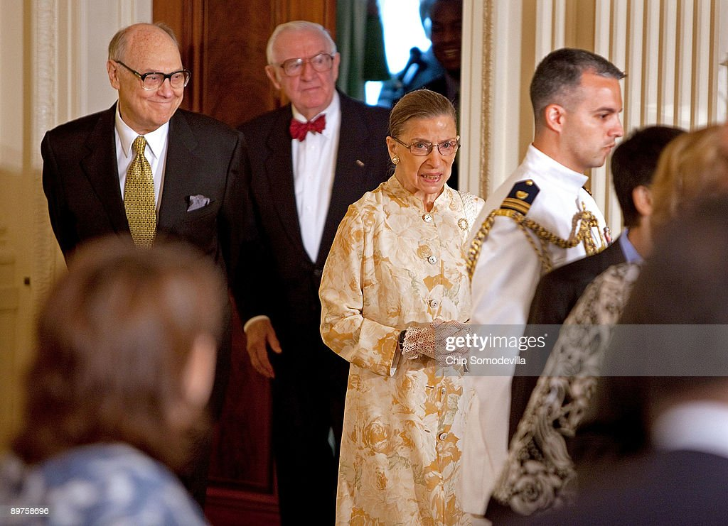 Georgetown Law Professor Martin D. Ginsburg (L) accompanies his wife U.S. Supreme Court Associate Justice Ruth Bader Ginsburg (C) with Associate Justice John Paul Stevens (2nd L) during a reception for new Supreme Court Associate Justice Sonia Sotomayor in the East Room of the White House August 12, 2009 in Washington, DC. Sotomayor, who is the first Hispanic and the third woman to be appointed to the Supreme Court, is expected to begin hearing oral arguments with the other justices in September.