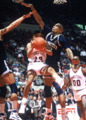 Georgetown's Alonzo Mourning defends against the University of Connecticut Hartford CT 1990