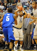 Georgetown's Austin Freeman pulls up for a 3point shot against UNCAsheville during the first half of their NCAA basketball game on November 27 at the...