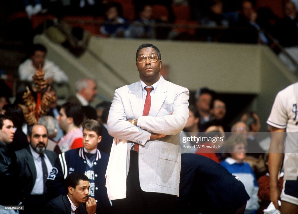 Georgetown's coach John Thompson looks on with arms crossed during a game against UConn at Hartford CT 1990