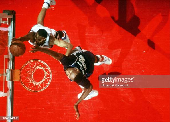 Georgetown's Dikembe Mutombo contests a shot by UConn's Chris Smith Hartford CT 1990
